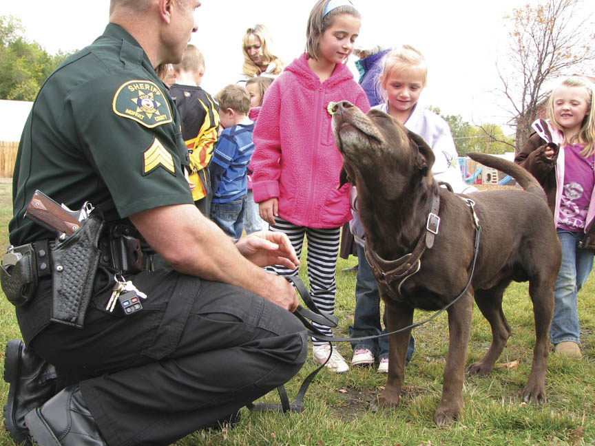 Moffat County Sheriff's Office Sgt. Courtland Folks introduces students from Eagle's Nest Preschool to Czar, a K-9 used by the department in 2010.
