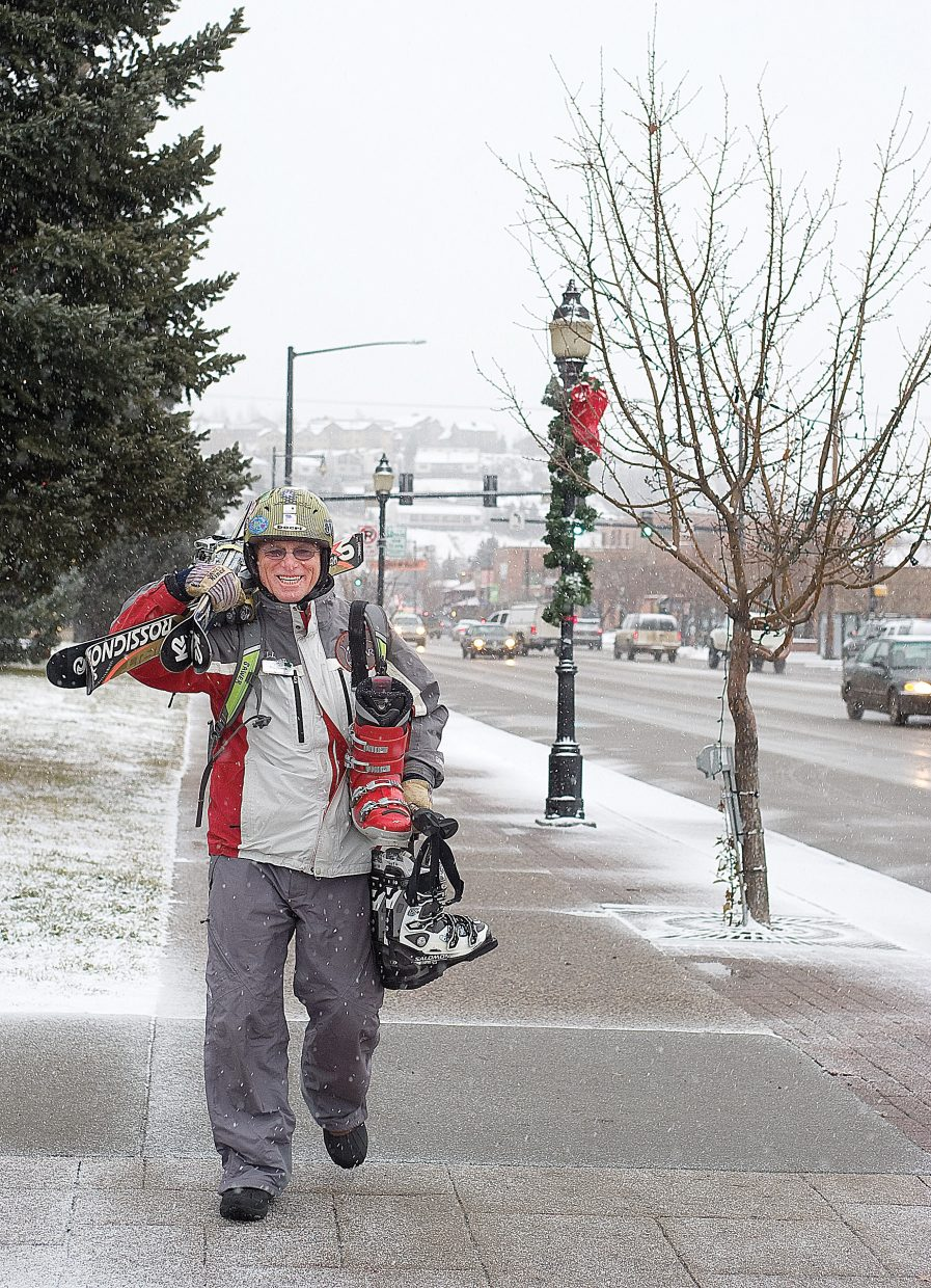 Bill Sawer was all smiles as he walked through the snow in downtown Steamboat Springs on Tuesday afternoon. Winter storms are expected to bring snow and colder temperatures to the area during the next few days. An automated forecast by the National Weather Service for Storm Peak at the top of Steamboat Ski Area expects between 15 and 23 inches of snow to fall overnight and during the day Wednesday.