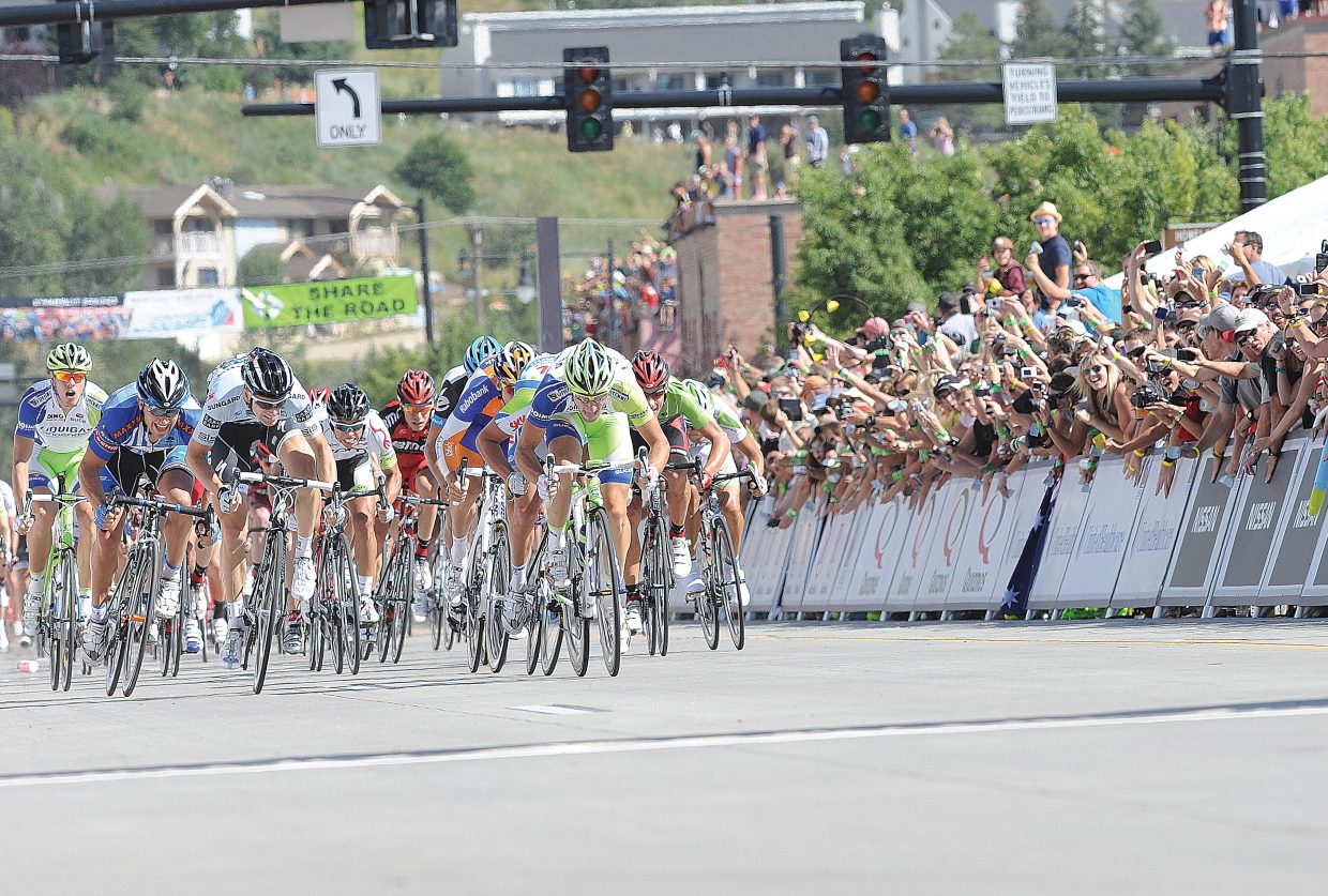 Thousands of spectators cheer as Elia Viviani, of Team Liquigas-Cannondale, races toward the finish line of Stage 4 of the USA Pro Cycling Challenge in Steamboat Springs in 2011.