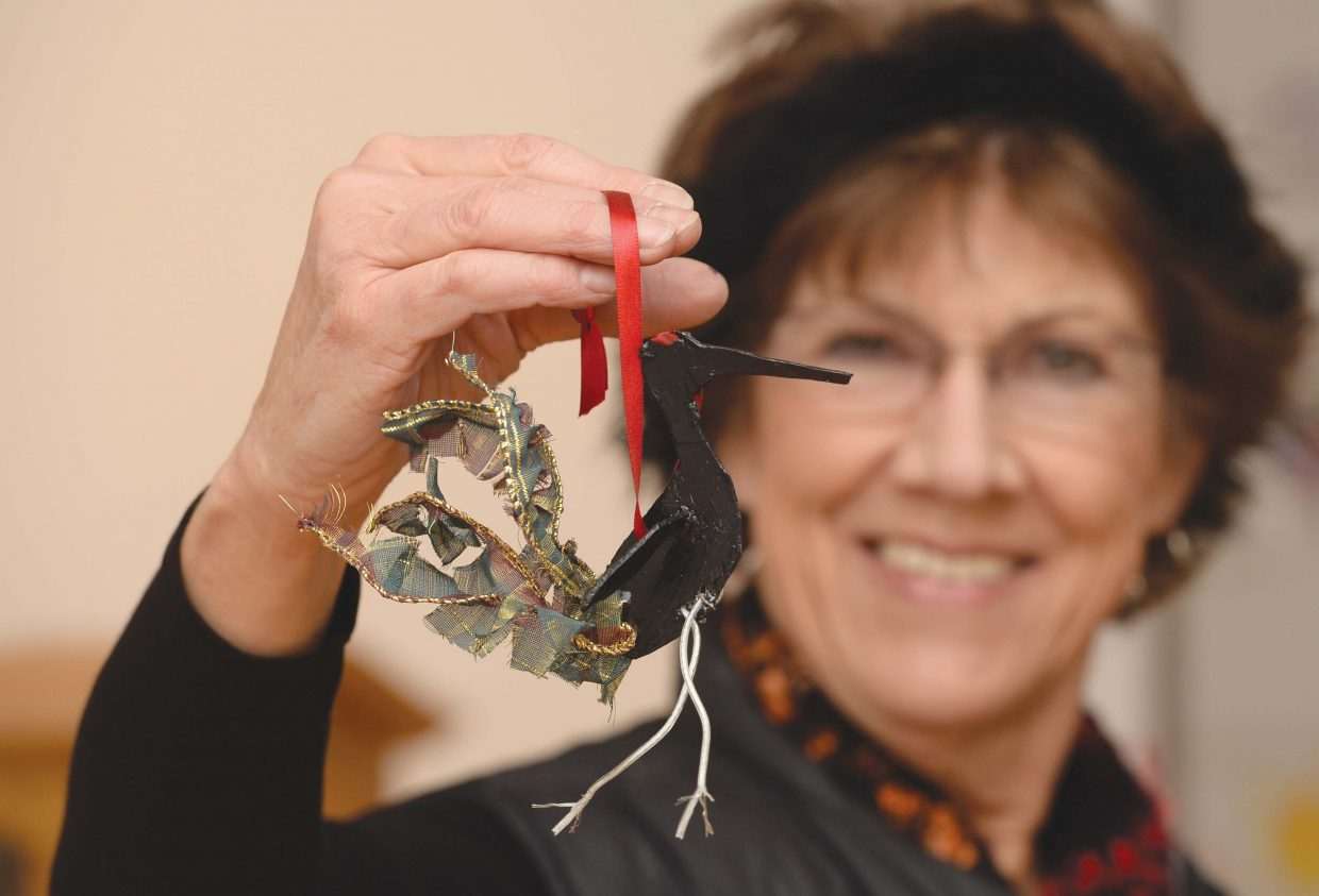 Mary Kay Ghiglia holds up a crane ornament she made for the Gift Arts show that will take place this weekend at the Deport Art Center.