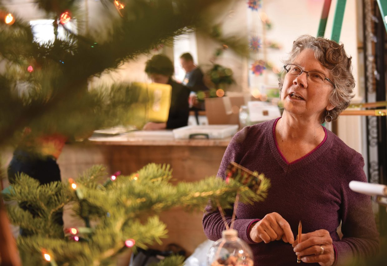 Cindy Wither checks out the ornaments hanging on a tree as part of the Gift exhibit at the Depot Art Center in 2015.