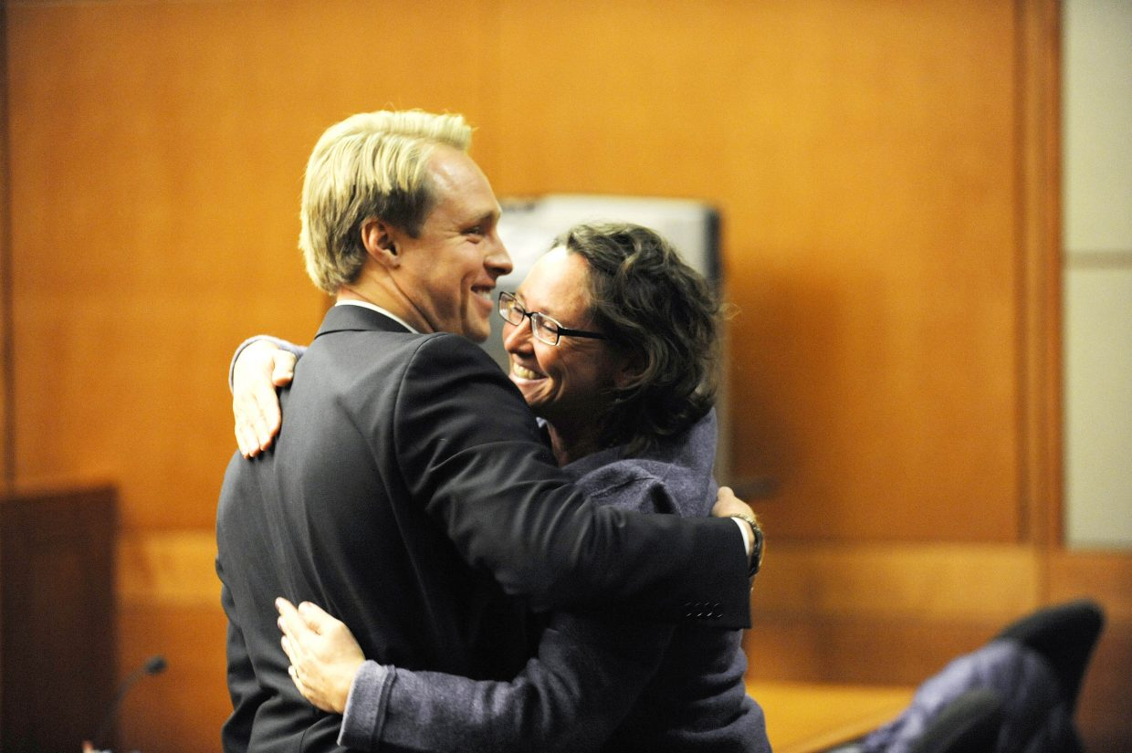 Former Steamboat Springs police officer Kristin Bantle hugs her attorney Matt Tjosvold after being found not guilty Thursday of felony attempt to influence a public servant.