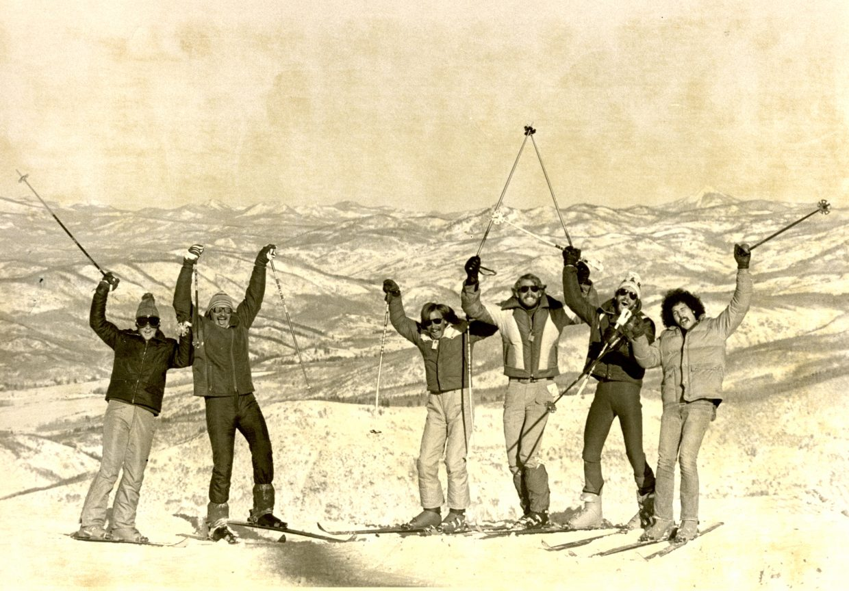 A six-pack of skiers show their enthusiasm atop the Vagabond Trail for opening day 1979 at the Steamboat Ski Area.
