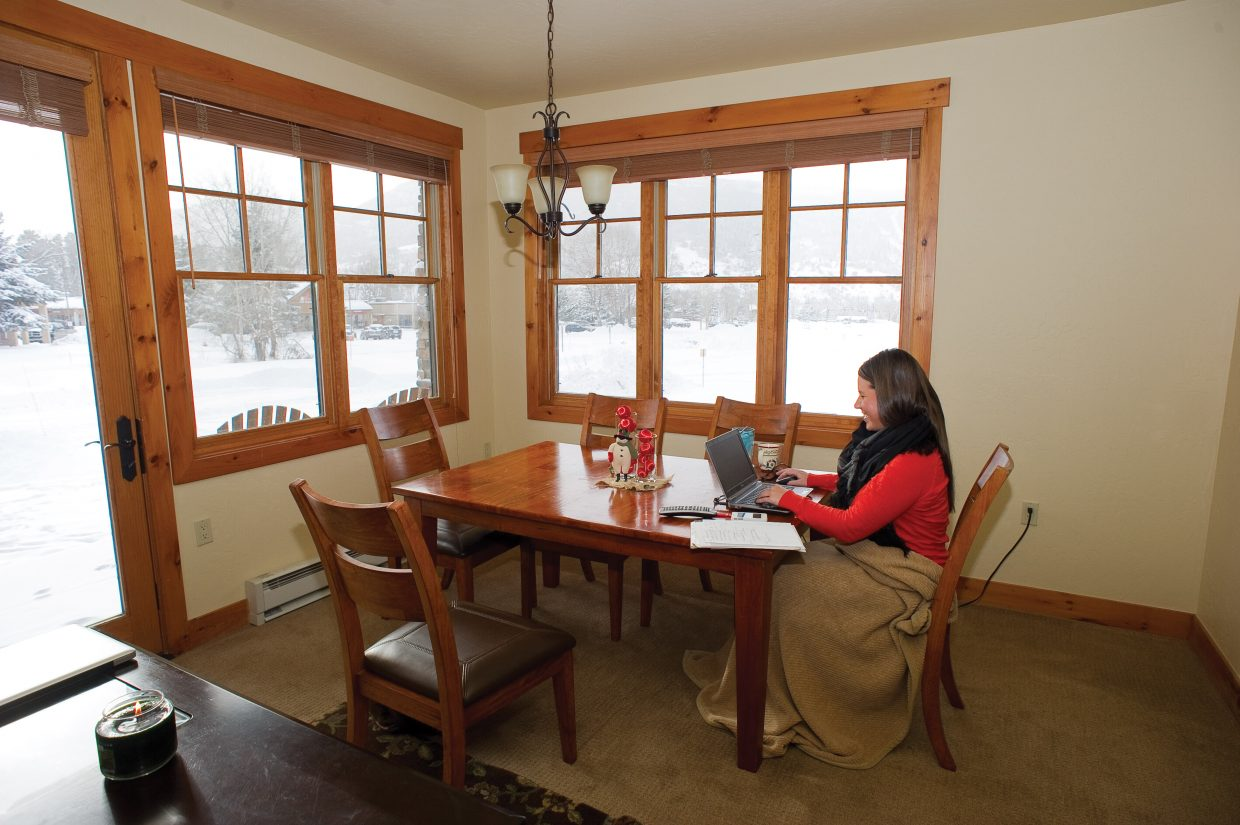 Amy Anderson works at her dining room table in Steamboat Springs. Anderson is a program manager for Oracle and coordinates events across North America for training and introducing new products to clients.