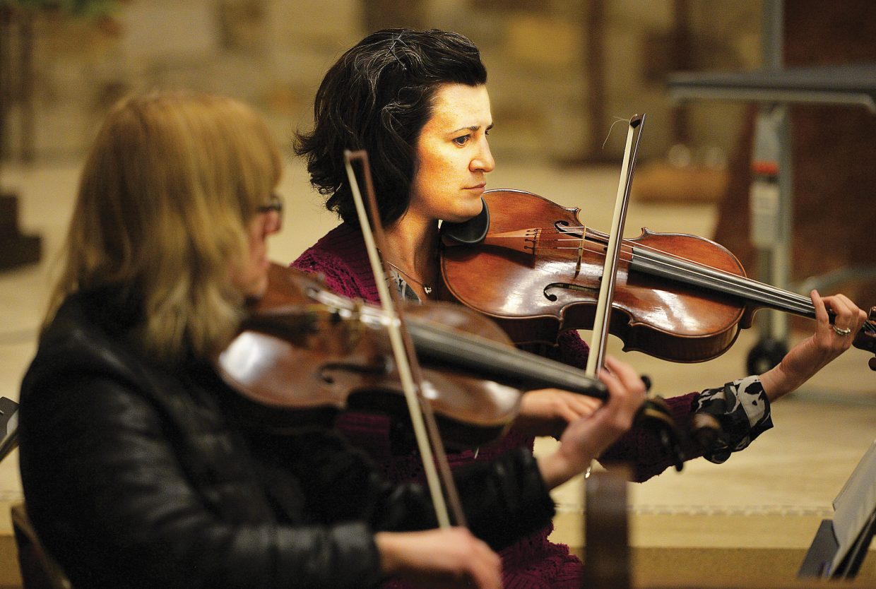 Danielle Johnson and Mary Anne Fairlie play their violas with the Steamboat Springs Symphony Orchestra during a rehearsal Wednesday evening at the Holy Name Church for the Christmas Spectacular. The Christmas Spectacular will take to the stage at 7 p.m. Saturday and 4 p.m. Sunday at Strings Music Pavilion.