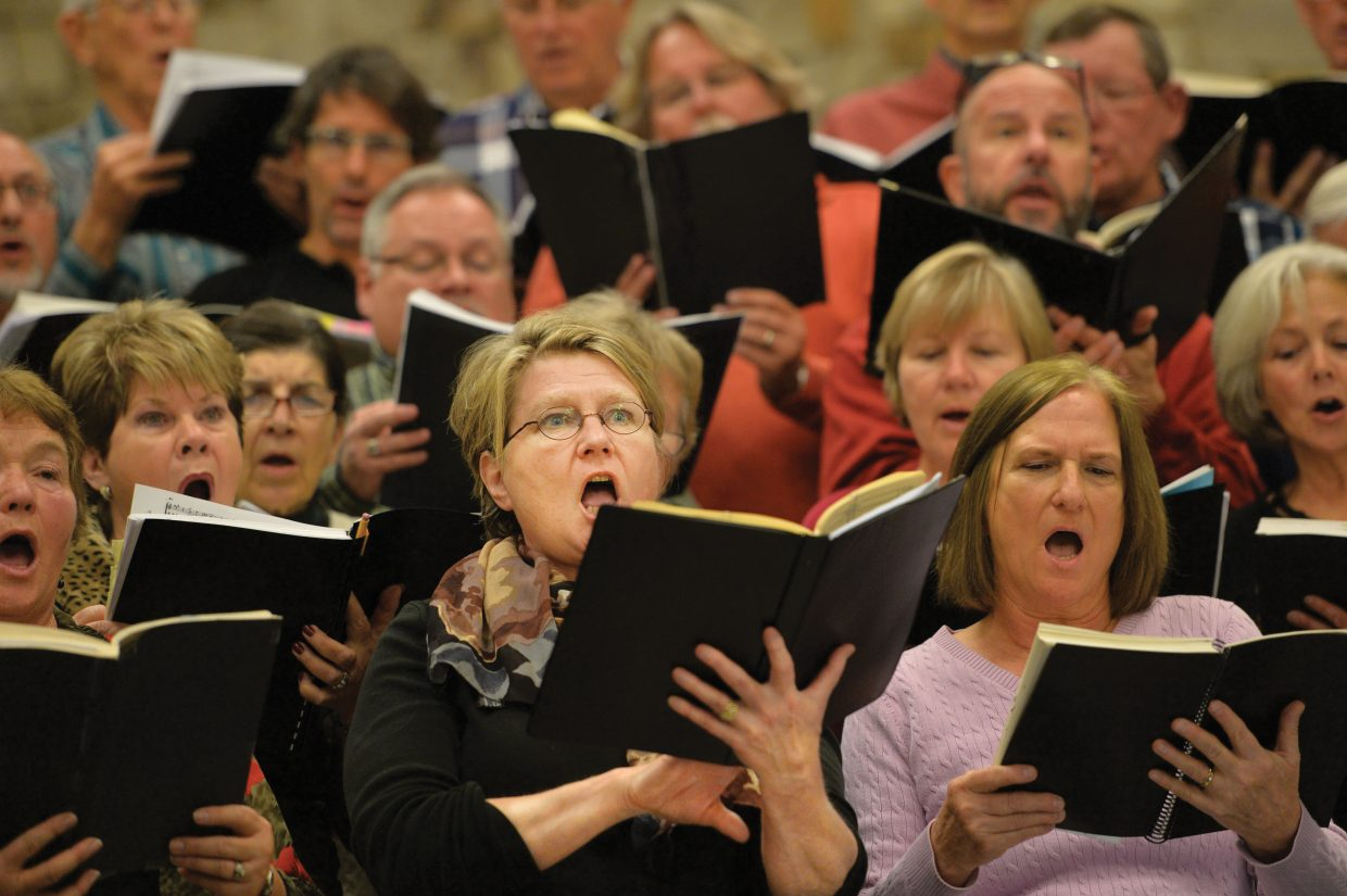Nancy Kramer, center, sings with the Yampa Valley Choral Singers during a rehearsal Wednesday evening at the Holy Name Catholic Church for the Christmas Spectacular.