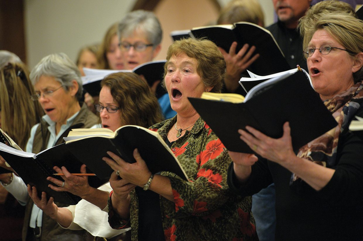 Ruth McClelland, center, sings with the Yampa Valley Choral Singers during a rehearsal Wednesday evening at the Holy Name Church for the Christmas Spectacular. The Christmas Spectacular will take to the stage at the Strings Music Pavilion at 7 p.m. Saturday and 4 p.m. Sunday.