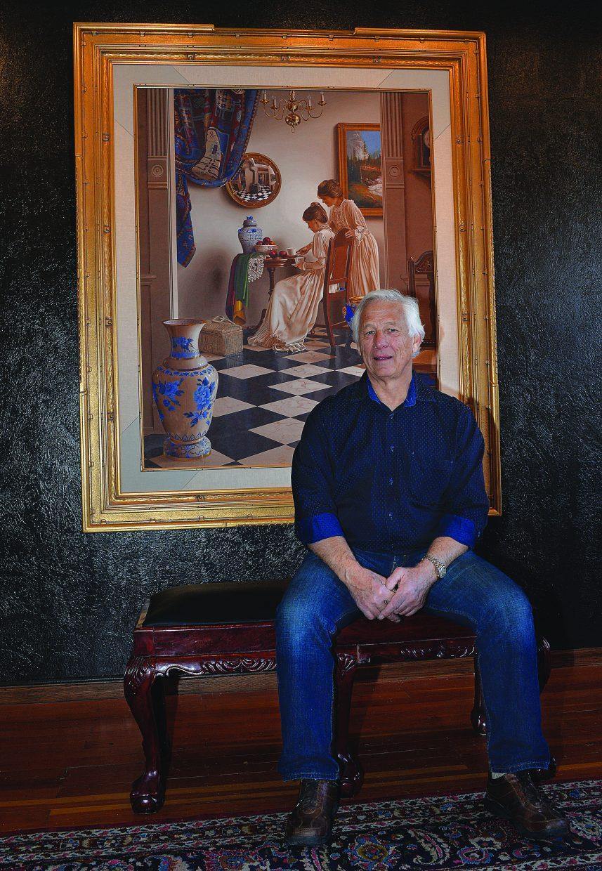 Mark Thompson, an egg tempera and etching artist, sits in front of one of his paintings at the Steamboat Art Museum. You can see Thompson's work starting Friday during the First Friday Artwalk.
