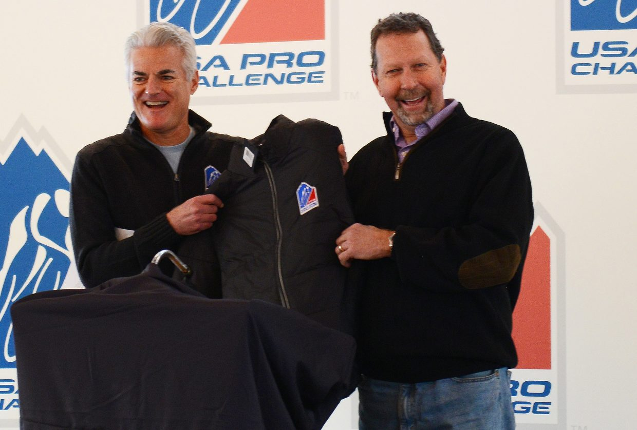 USA Pro Challenge CEO Shawn Hunter and Steamboat Ski Area Vice President Jim Schneider show off a race jacket Thursday morning after it was announced that Steamboat Springs would be the host for the first and second stages of the August 2015 cycling stage race.