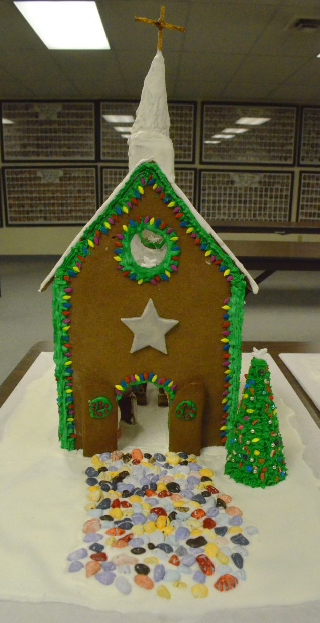 A church created by Brandon Madsen welcomes worshipers as part of the gingerbread house contest hosted by the Museum of Northwest Colorado and Downtown Business Association.