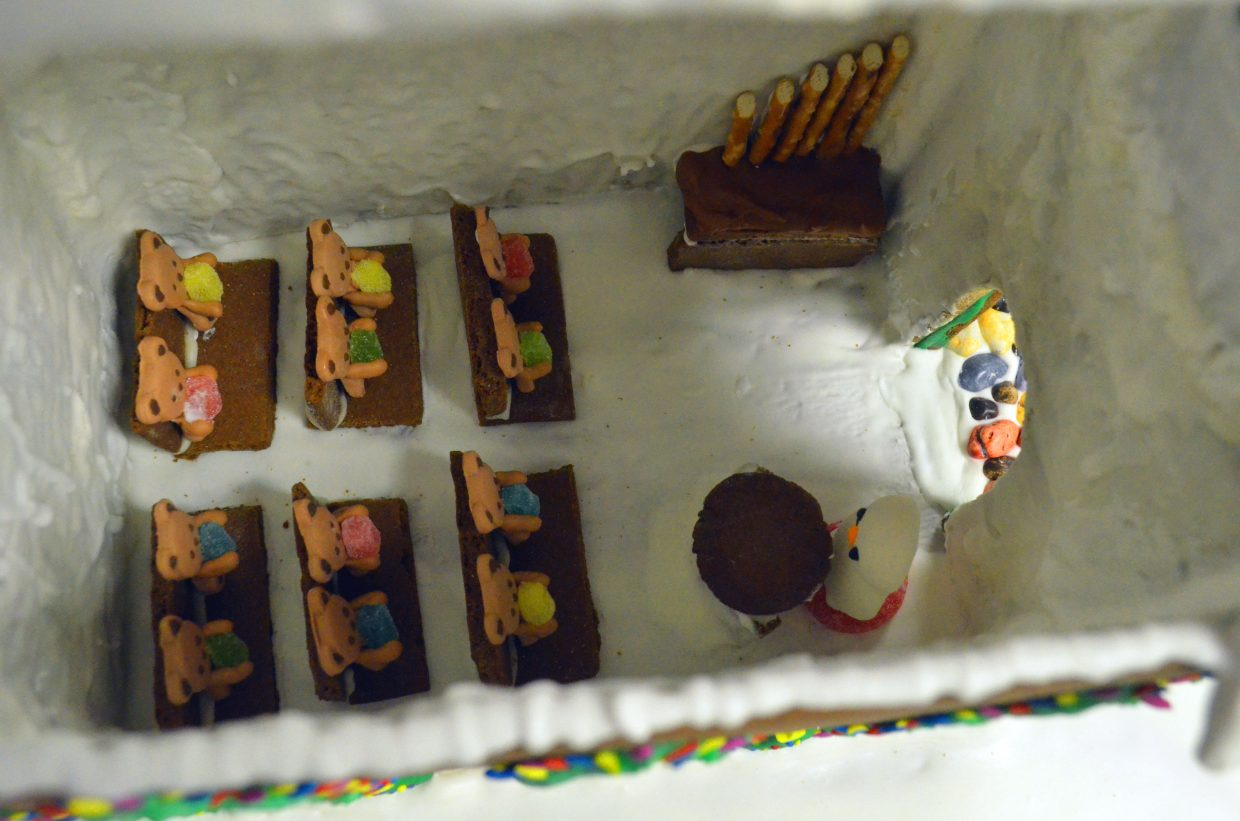 Edible bear parishioners and a snowman made of frosting fill the church made by Brandon Madsen as part of the gingerbread house contest hosted by the Museum of Northwest Colorado and Downtown Business Association.