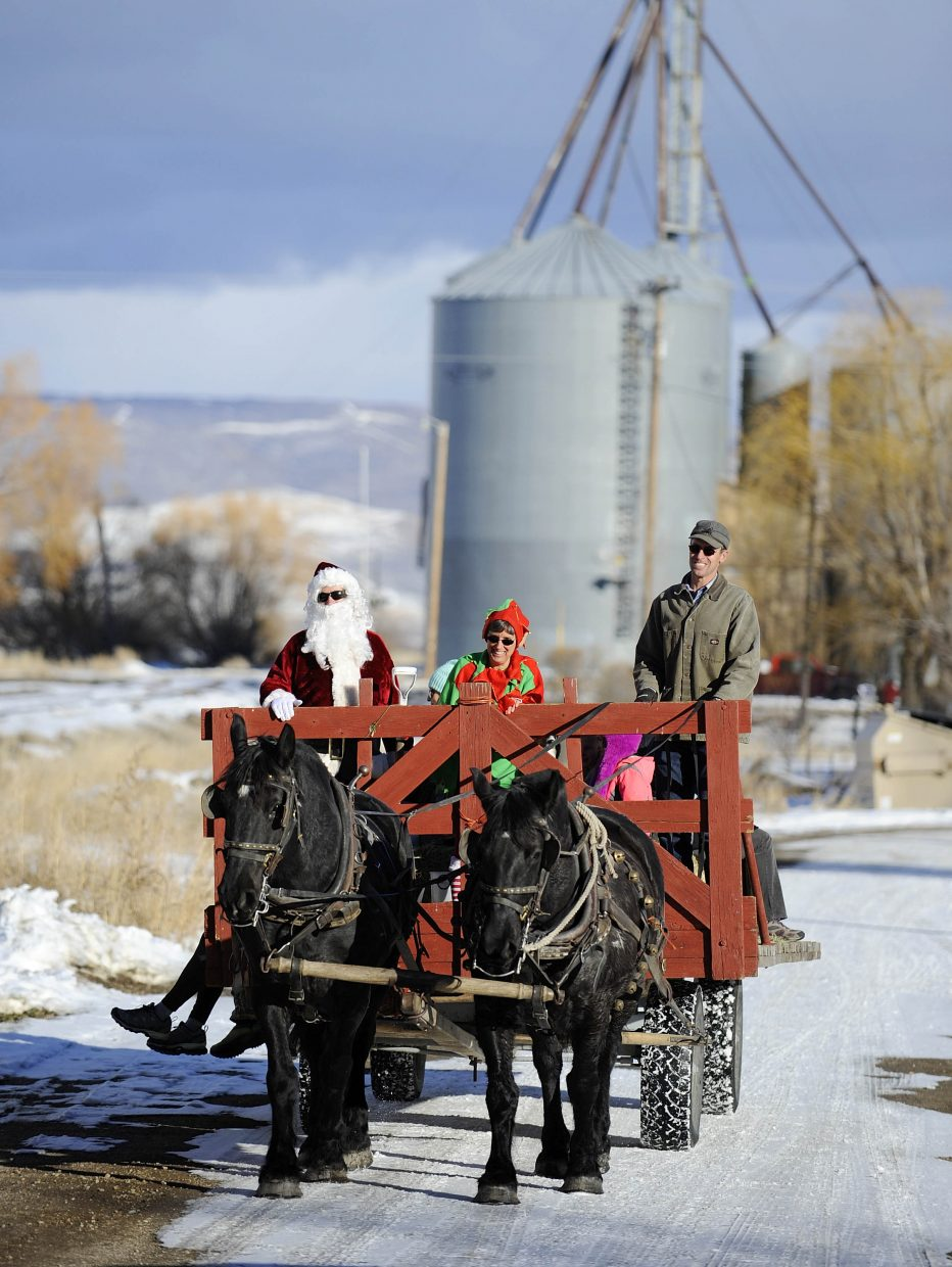 Ryan Wattles gives hayrack rides Saturday during the Holiday Stroll in Hayden.