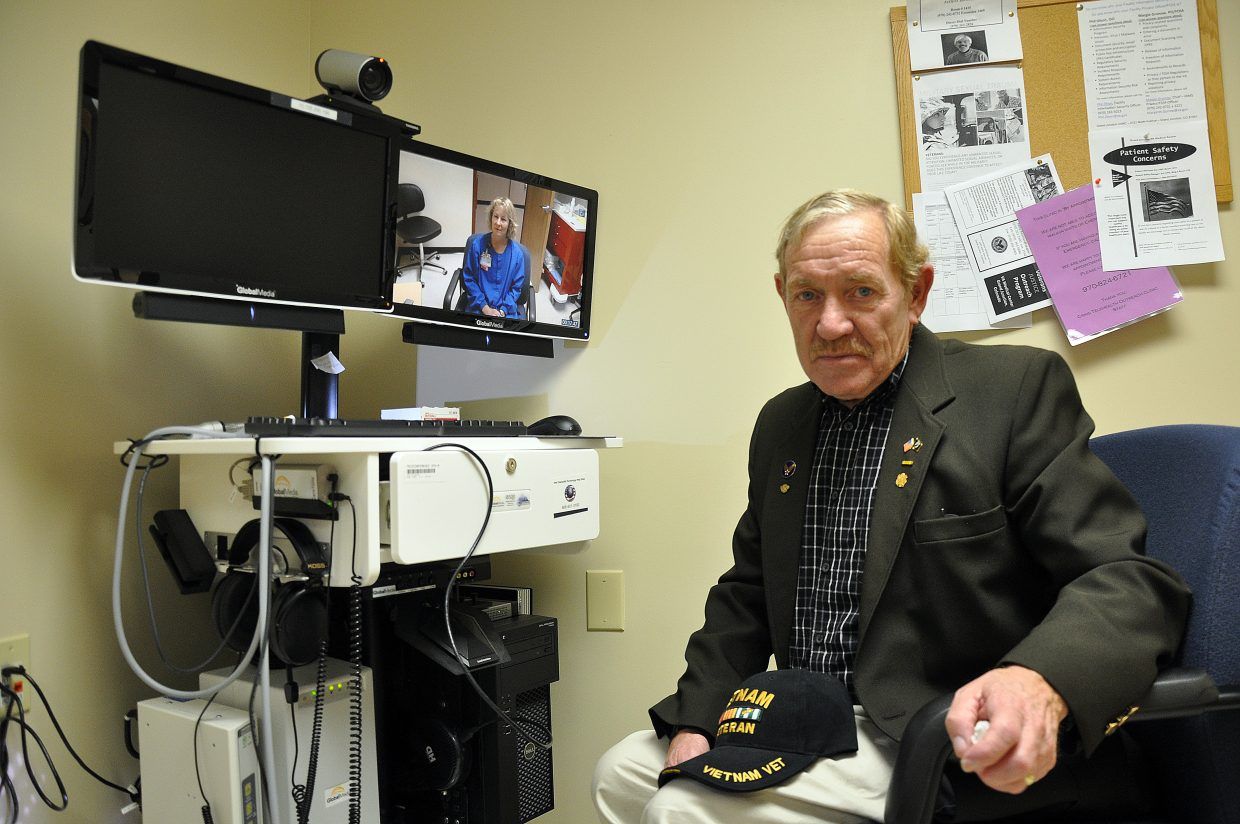 Army veteran Andrew Seed demonstrates the telehealth technology used at the Major William Adams Veterans Telehealth Clinic in Craig in 2013. The clinic continues to expand the number of services offered using telehealth technology connecting patients with doctors in Grand Junction.