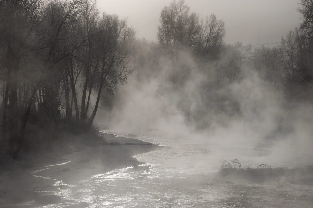 Fog rises off the waters of the Yampa River on Thursday in downtown Steamboat Springs. Temperatures dipped overnight, making for a chilly morning.