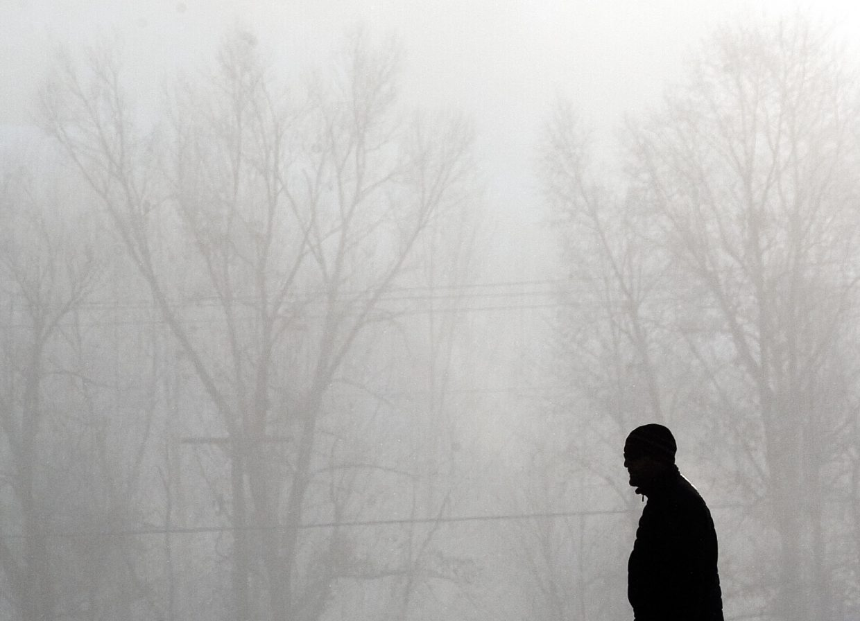 A pedestrian makes his way through the fog in downtown Steamboat Springs on Thursday morning. A cold front swept through the area overnight, making for very cold conditions in the area.