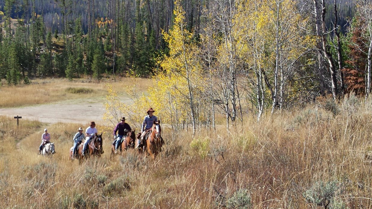 New ranch owner Bex Damman leads a trail ride over the summer at the Elk River Guest Ranch.
