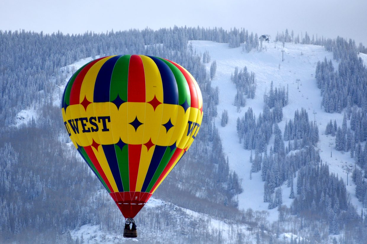 A hot air balloon takes flight Friday morning over the Yampa Valley. Subzero temperatures didn't stop passengers from enjoying the view of Steamboat Ski Area.