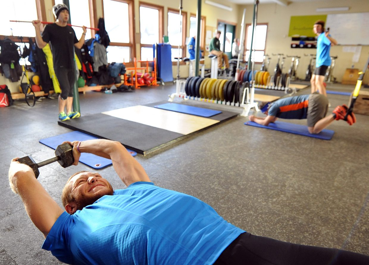 Aleck Gantick, bottom, pumps iron as other members of the National Training Group work out in the David DeHaven Strength Training Center at Howelsen Hill in Steamboat Springs.