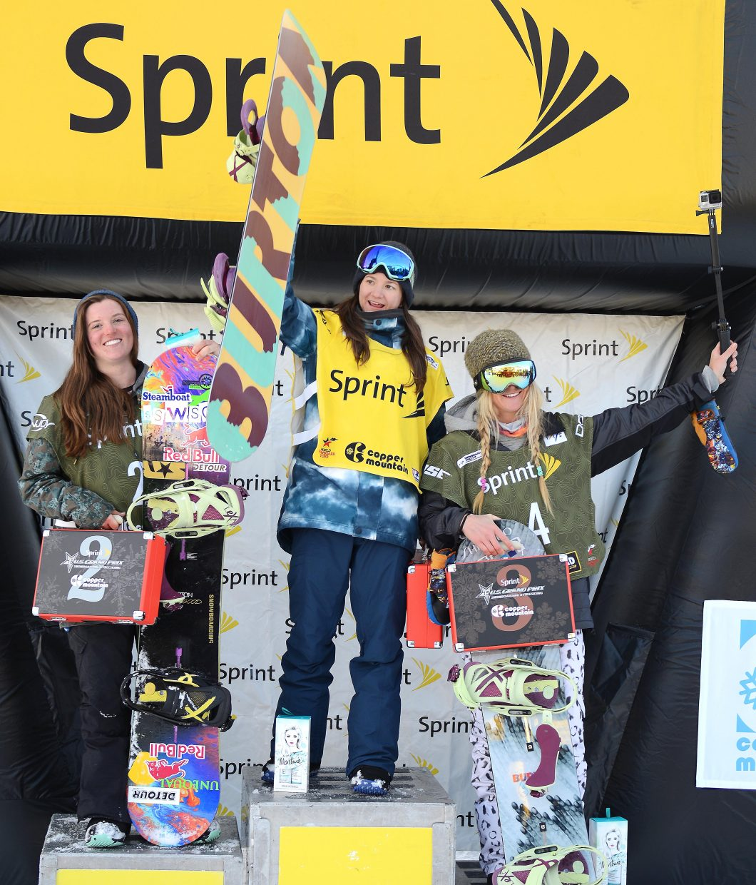Arielle Gold, left, stands on the podium with Kelly Clark, center, and Hannah Teter, on Saturday after finishing second in the US Grand Prix World Cup snowboard event at Copper Mountain.
