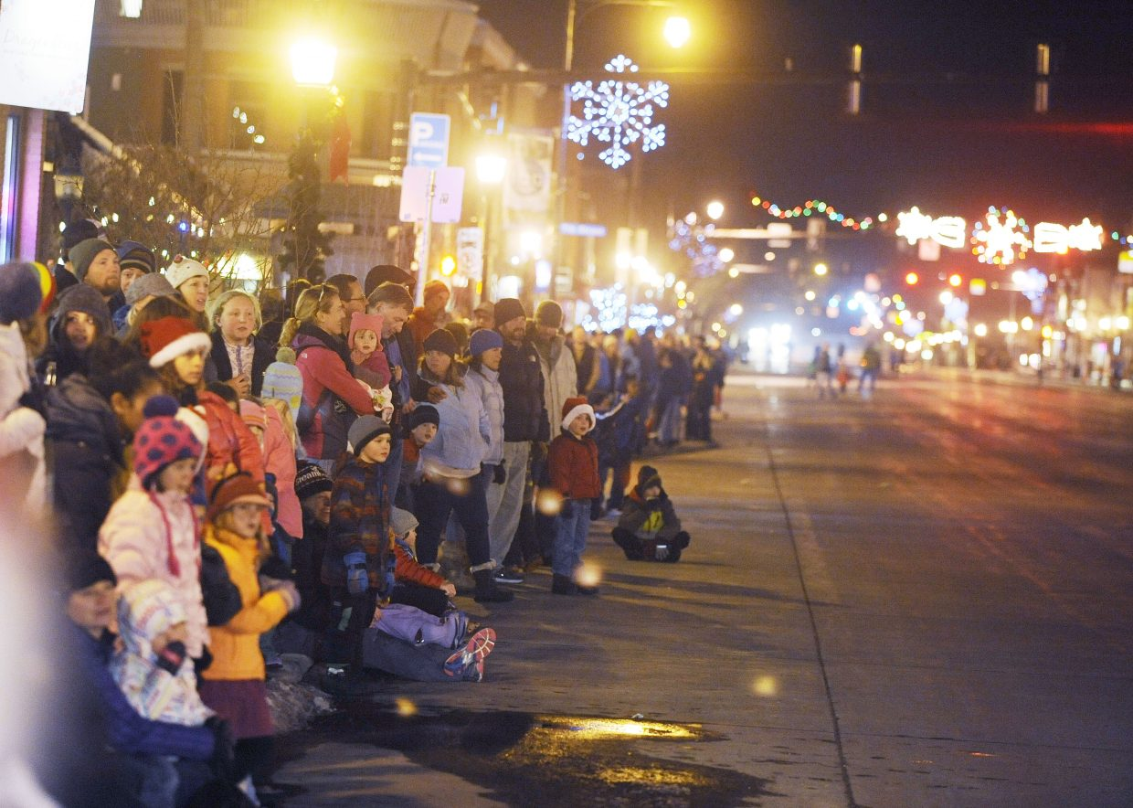 People line Lincoln Avenue on Saturday for the Merry Mainstreet parade.
