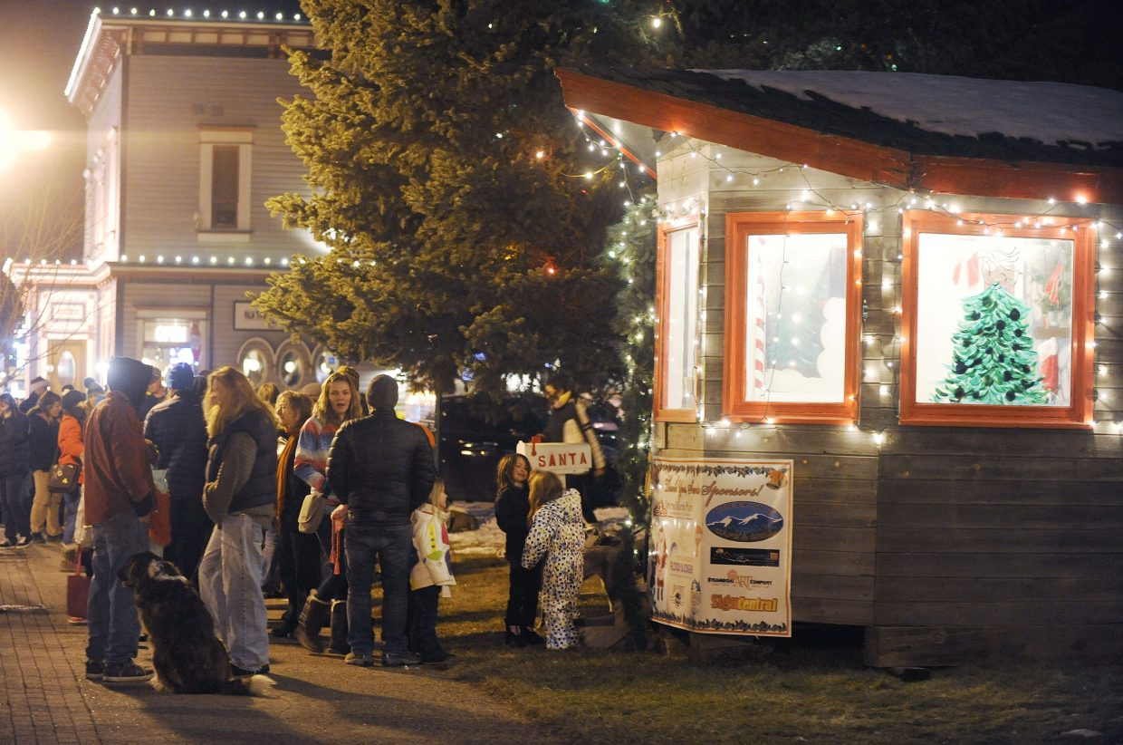 People line up to see Santa on Saturday during the Merry Mainstreet Holiday Celebration and Parade.