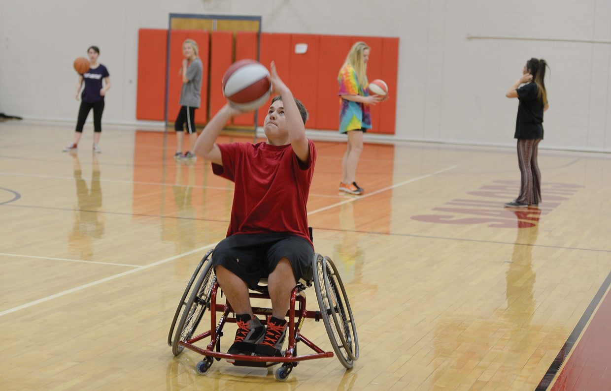 Steamboat Springs High School senior Rudy Arce looks to score a basket during a game of wheelchair basketball as part of his physical education class Friday. The program, which was put on with the help of STARS, gave students who would not normally use a wheelchair an opportunity to appreciate what it takes to play the game without the use of their legs.