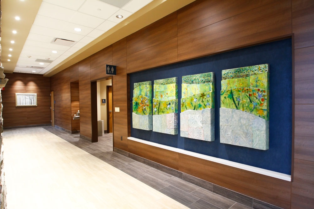 Noyes Art Designs created four artistic pieces for niches at Saint Anthony North Hospital in Denver. Collectively the pieces resembled a Colorado landscape.