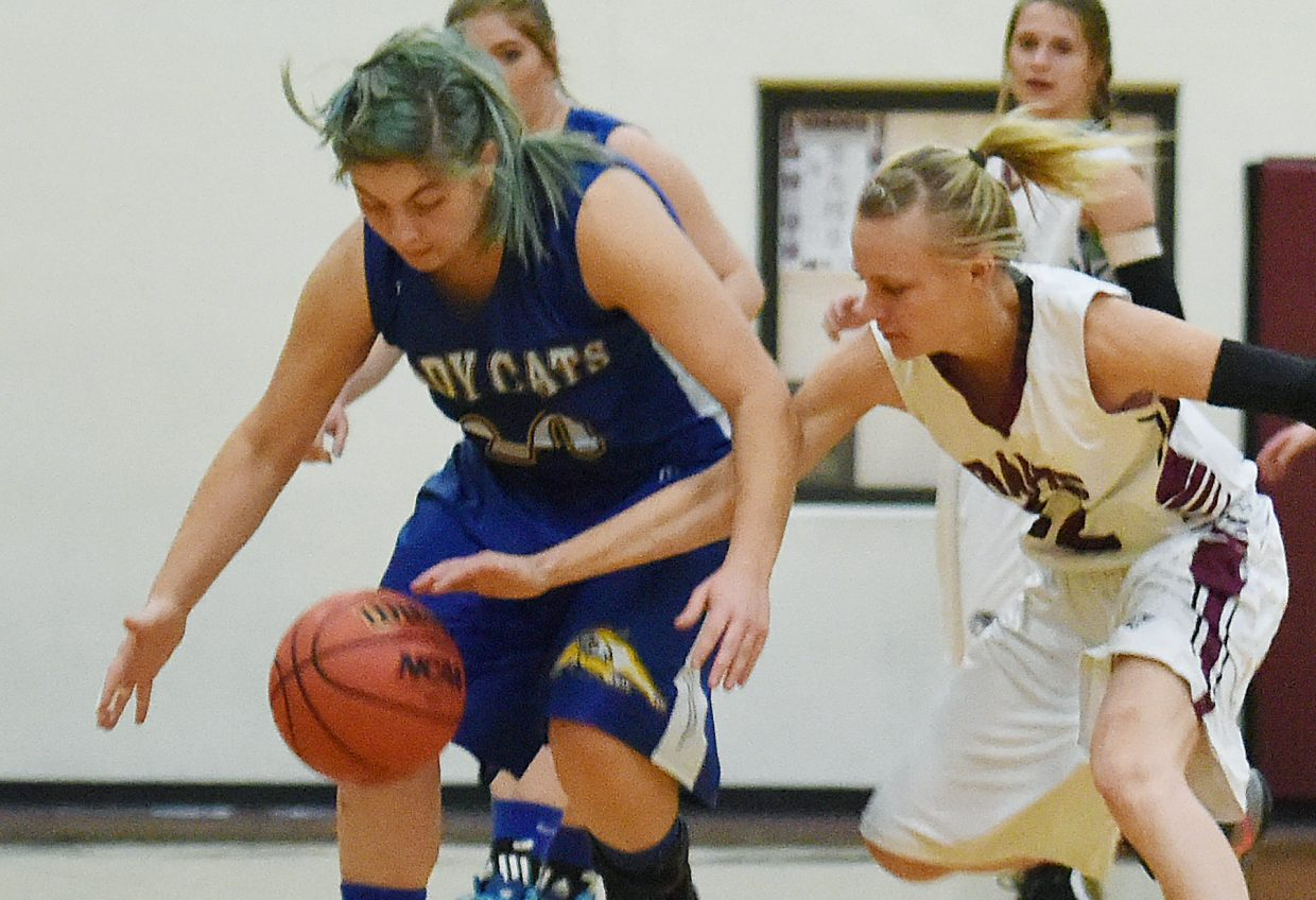 Soroco senior Morgan George reaches in to swipe away the ball Tuesday as the Rams ran up a big victory against North Park.