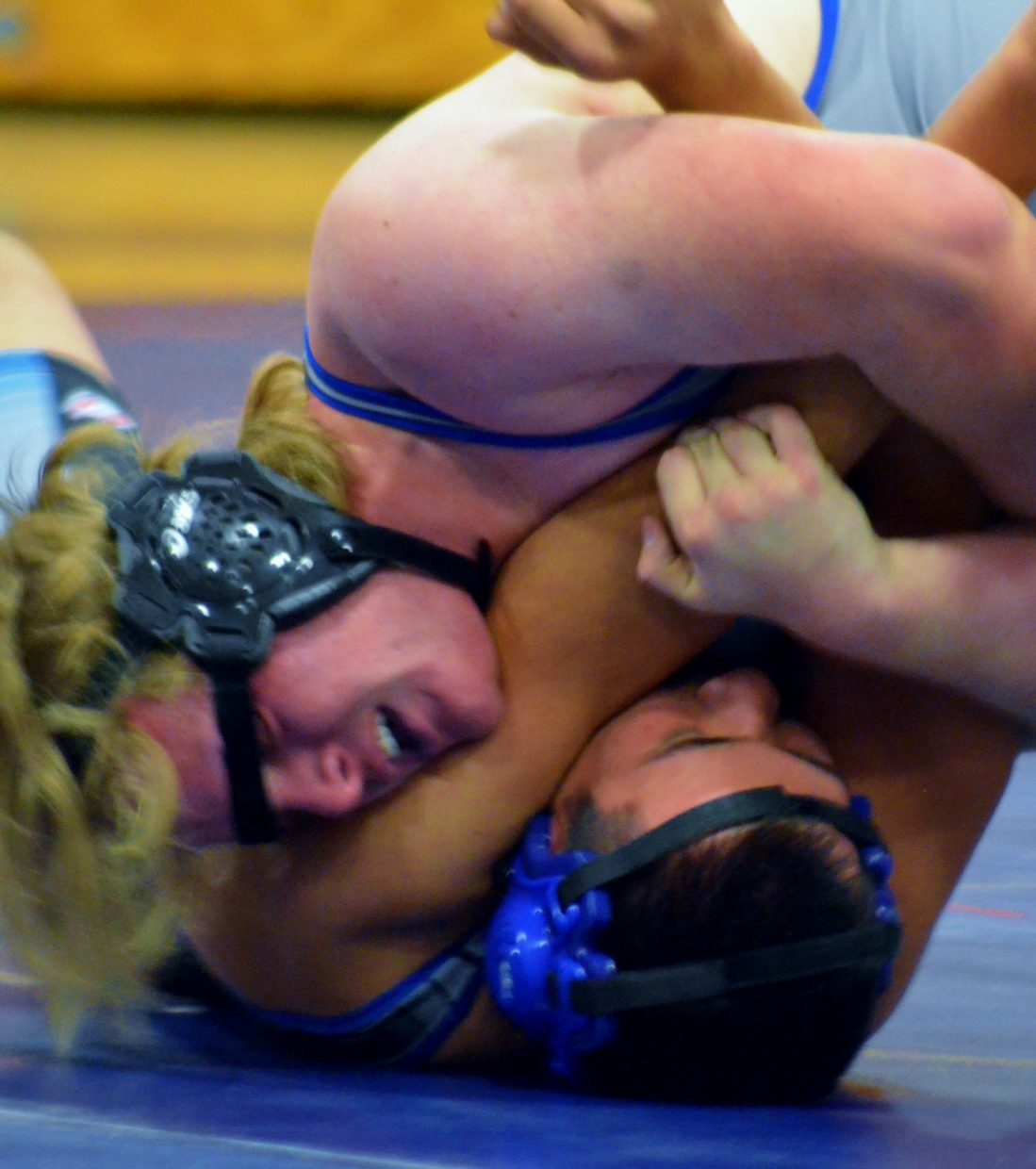 Moffat County High School's Drake Doherty drives Coal Ridge's Kevin Juarez to the mat during MCHS wrestling's Tuesday home triangular with Steamboat Springs and Coal Ridge.