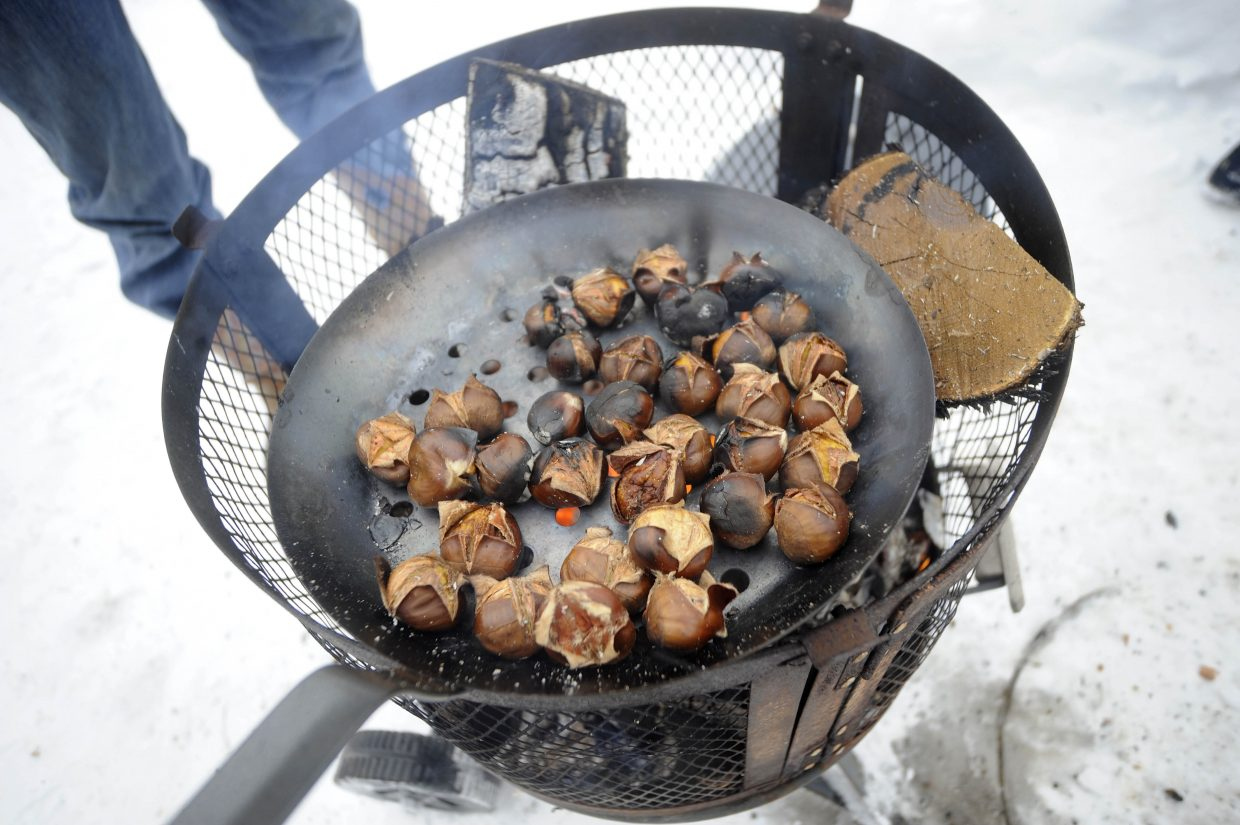 Chestnuts roast over a fire during the Holiday Stroll in Hayden.