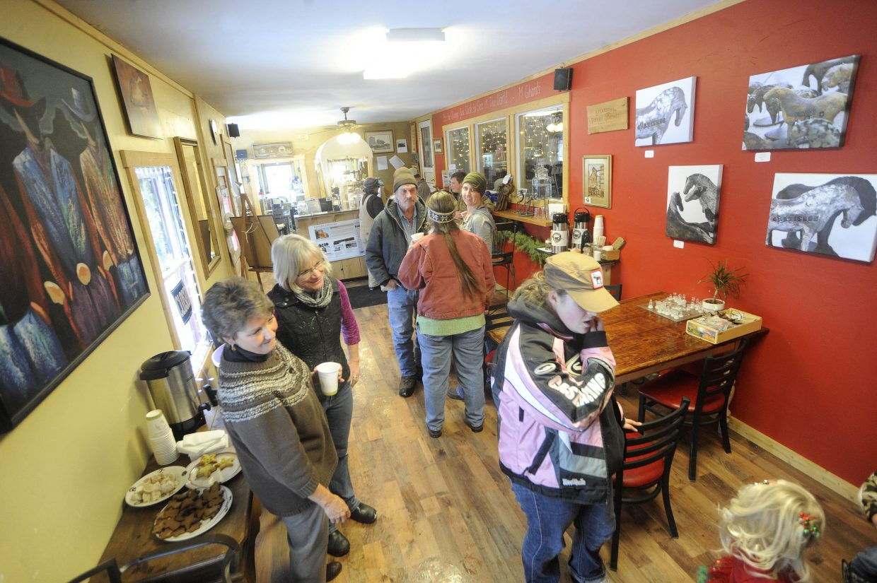 Residents gather at the Hayden Granary on Saturday during the Holiday Stroll.