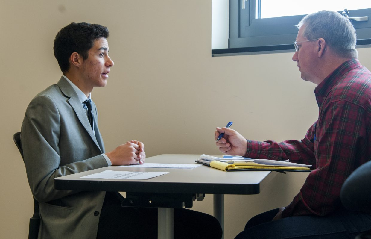 Christopher Blevins, a senior from Durango High School, talks with judge JB Chapman during a role play in the sports and entertainment management event at Monday's DECA district conference, held at Colorado Northwestern Community College.