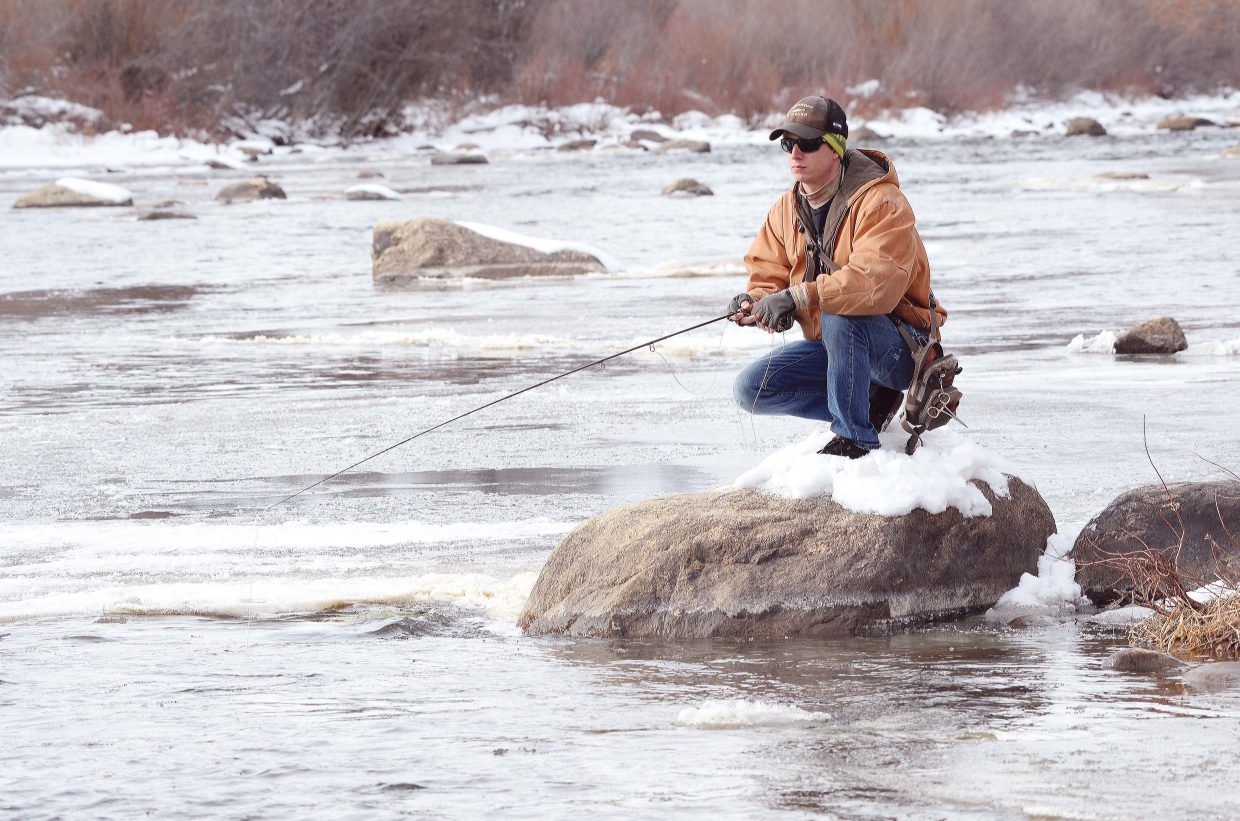 'Tis always the season for fishing cheer, according to local angler William Duffy. Despite Monday's chilly temperatures, and a little bit of ice on his leader, Duffy ventured into the waters of the Yampa River hoping to hook a trout.