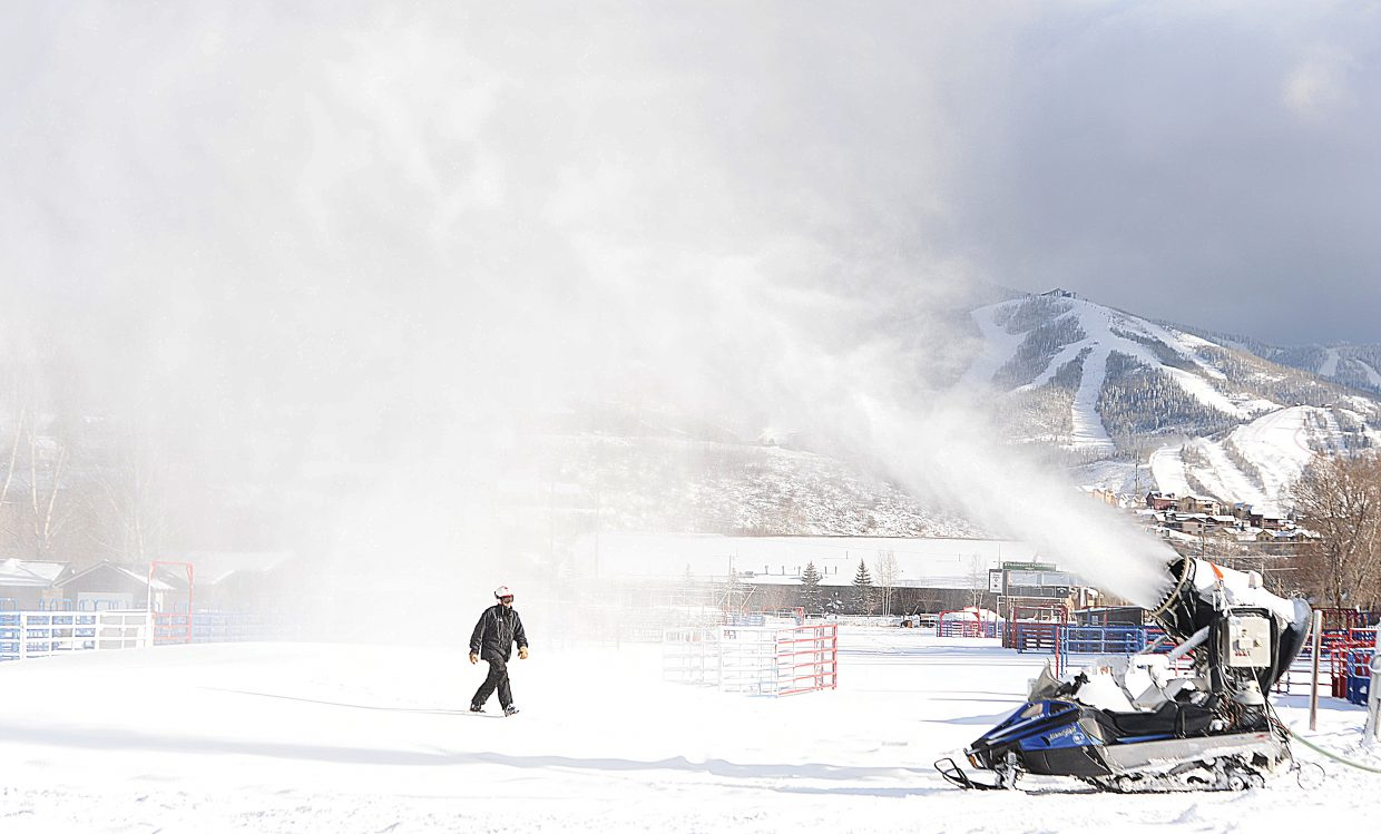 Snowmaker Scott Larson walks off of a pile of snow near the Howlesen Hill Rodeo Arena Wednesday afternoon and heads back to his snowmobile after checking a gun. Crews at Howelsen and Steamboat Ski Area have been busy the past few weeks as temperatures finally fell to the point that snowmaking operations are running at full speed.