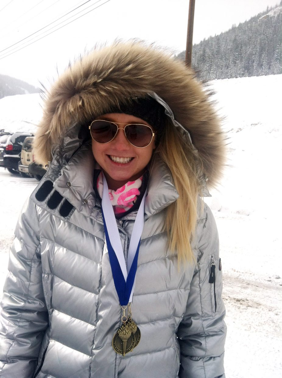 Steamboat skier Serina Kidd shows off her medals she won thanks to a pair of podium finishes in the U18 division of an FIS race in Loveland.