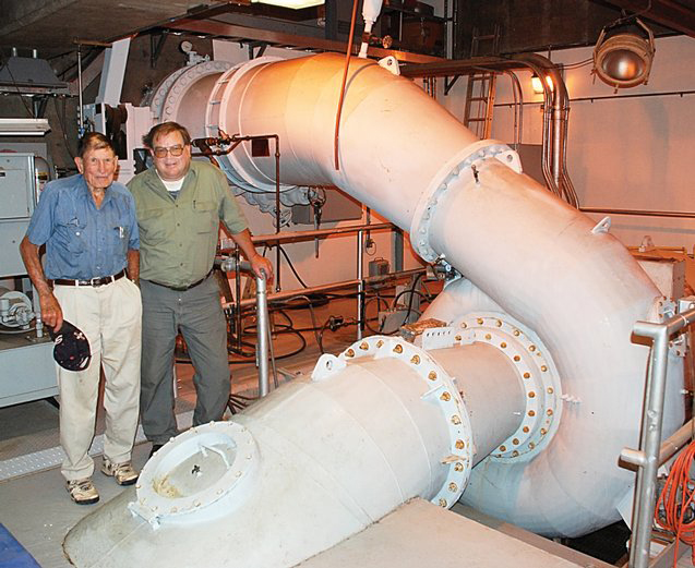 The late John Fetcher, former manager of Upper Yampa Water Conservancy District, and Stagecoach power plant operator Dan Ellertson inspected the machinery in August 2007. The power generated by the plant each month will now be sold directly to Yampa Valley Electric Association.