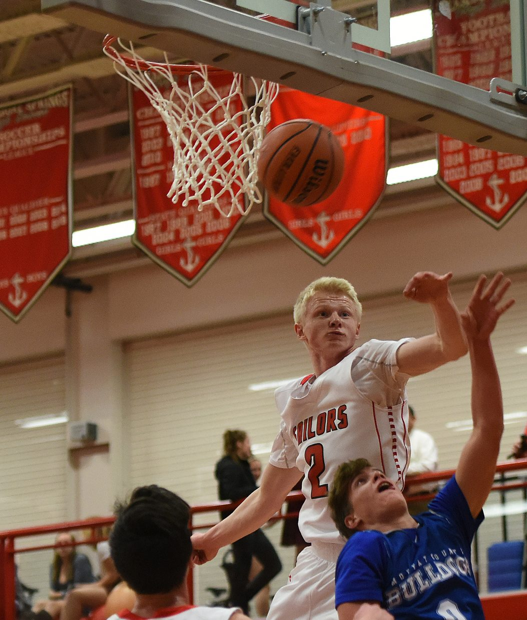 Steamboat senior Ethan Riniker swats away a shot Thursday against Moffat County. He finished with 21 points to lead all scorers, and three blocks.
