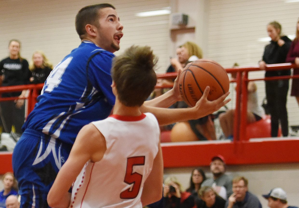 Moffat County's Brent Cook charges into Steamboat's Jake Berry on Thursday.