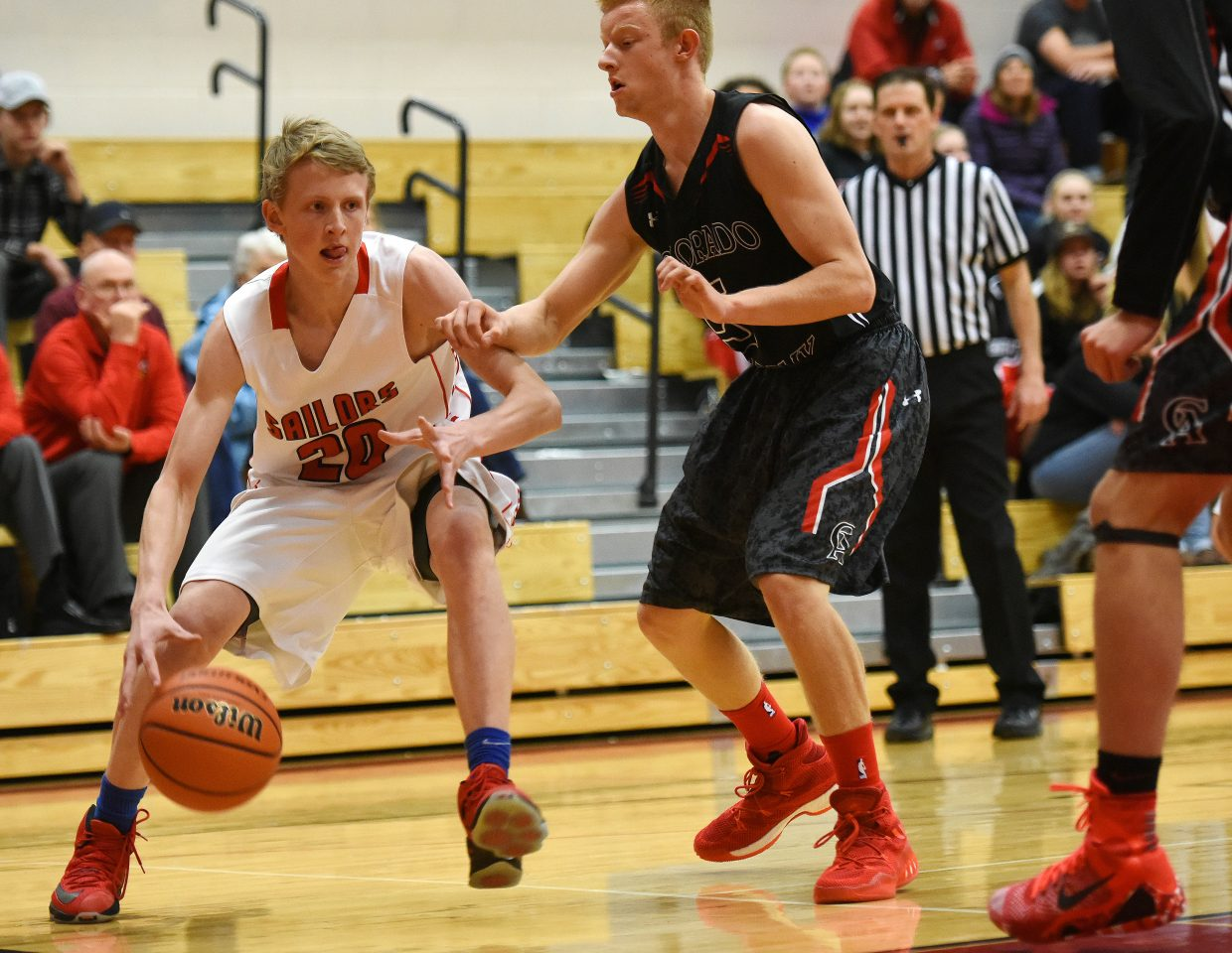 Steamboat's Mac Riniker looks to drive along the baseline Friday against Colorado Academy.