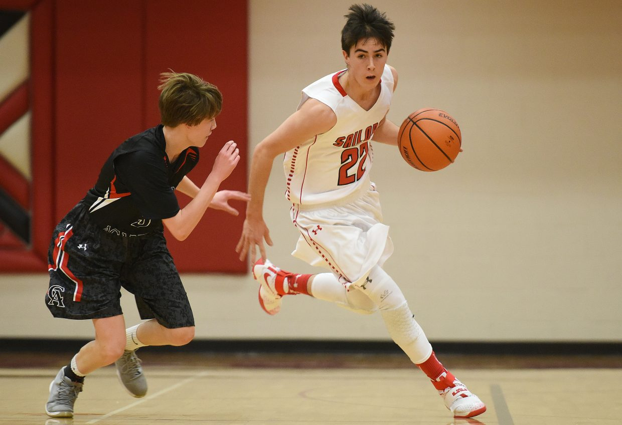 Steamboat's McKenyon King pushes the ball up the court Friday.
