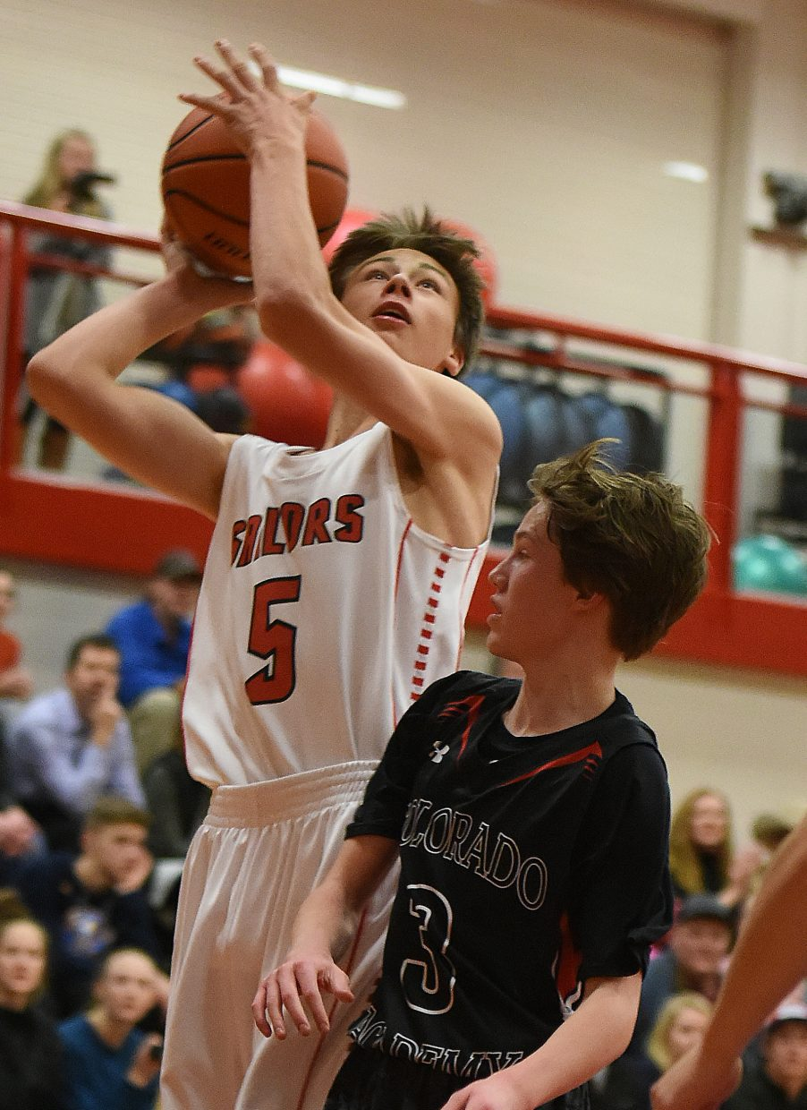 Steamboat's Tyler Doyne puts up a shot Friday against Colorado Academy.