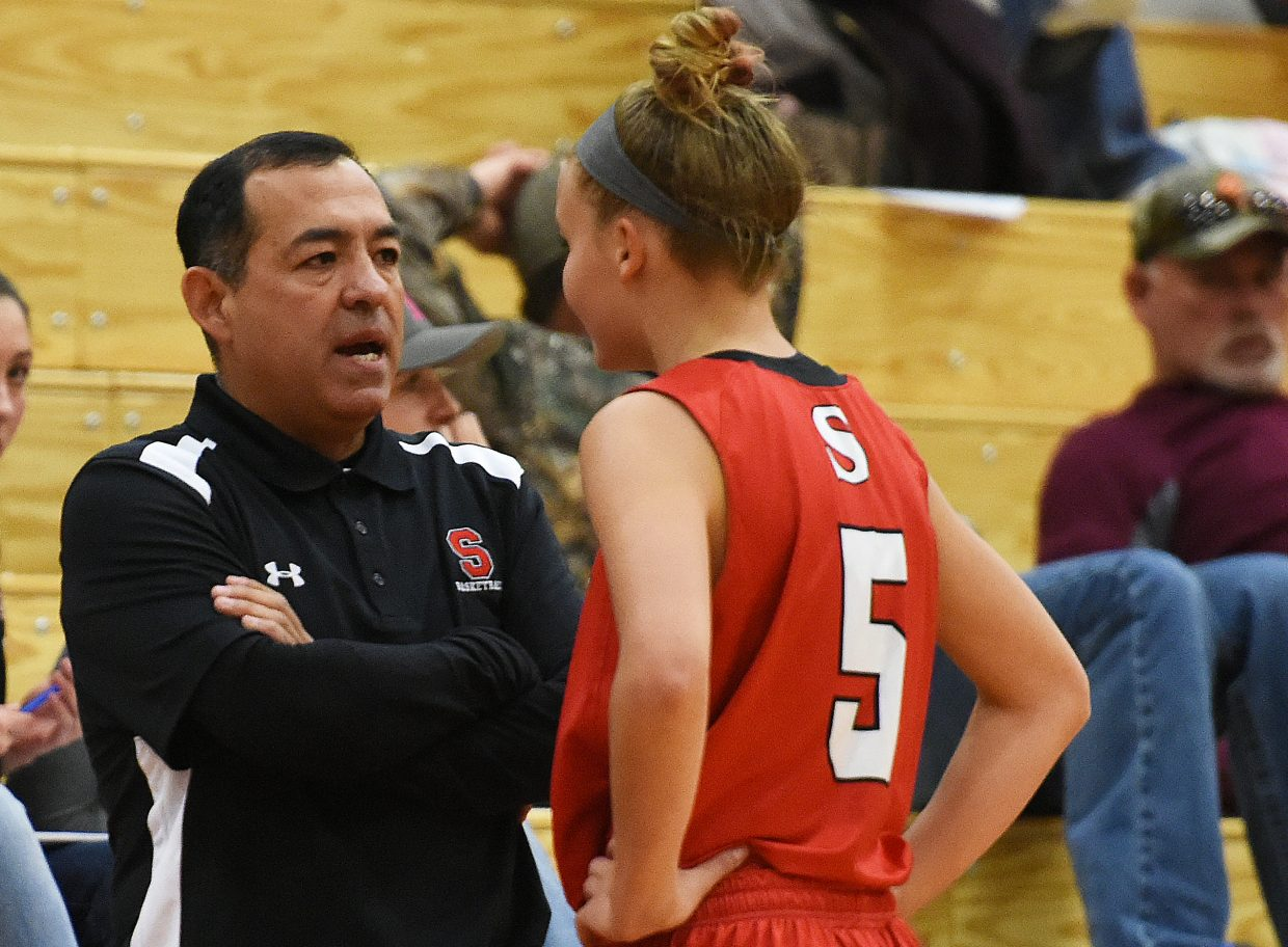 Steamboat coach George Ibarra and sophomore Lucy Shimek talk on the sideline Friday.