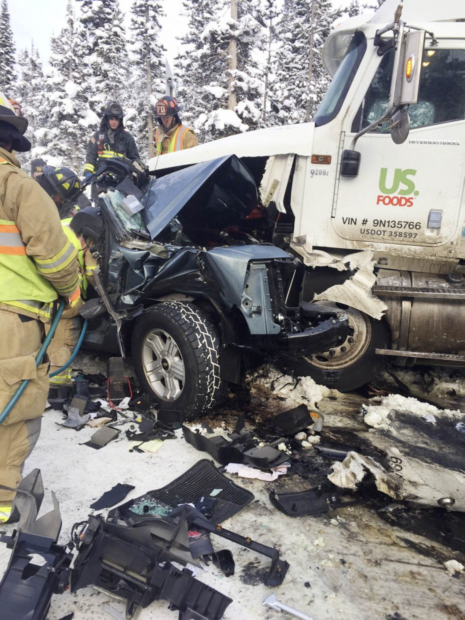 Firefighters work at the scene of the crash Thursday morning on Rabbit Ears Pass.