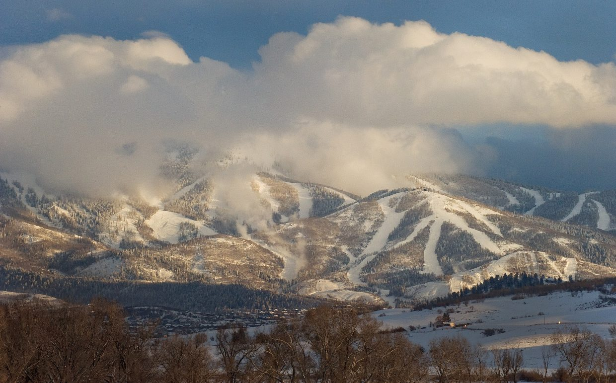 Clouds cling to the higher peaks of the Steamboat Ski Area late Sunday afternoon.