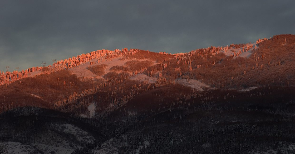 The sun sets on the slopes surrounding Steamboat Springs Monday afternoon.
