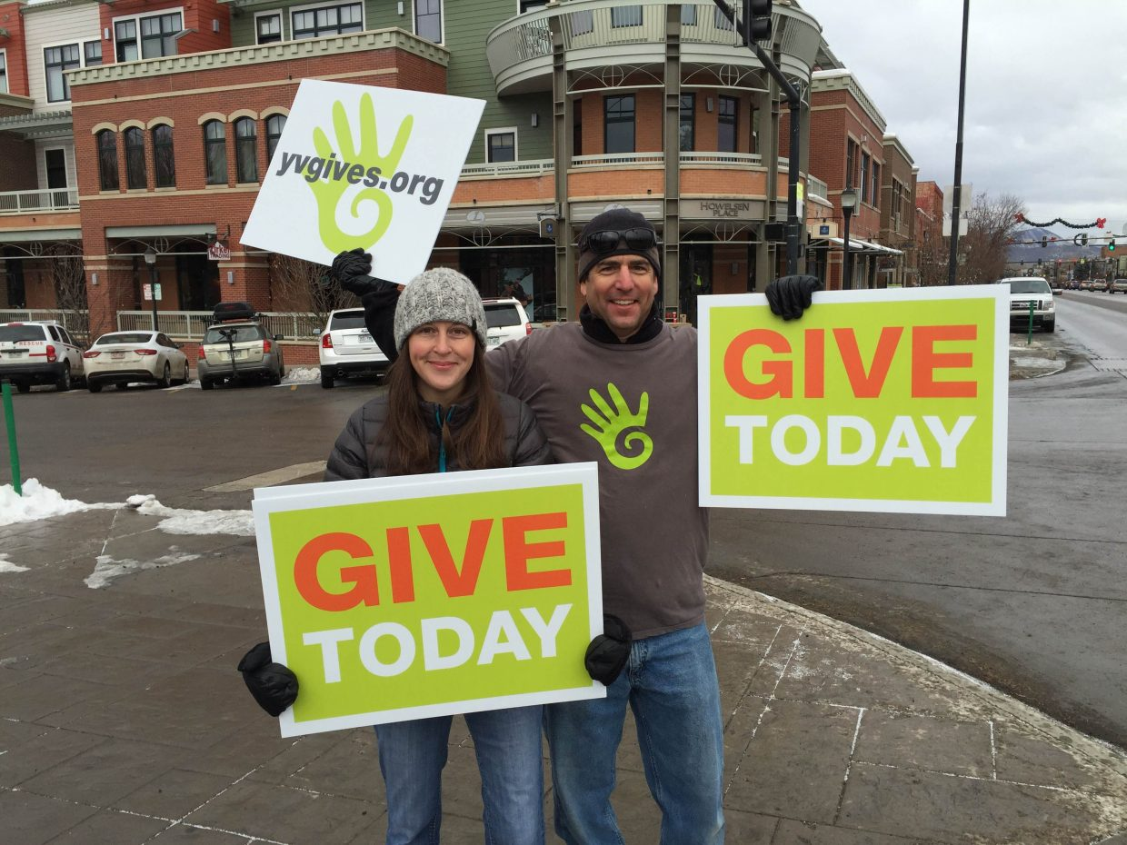 Yampa Valley Gives Day supporters wave signs encouraging people to donate to local nonprofits Tuesday.