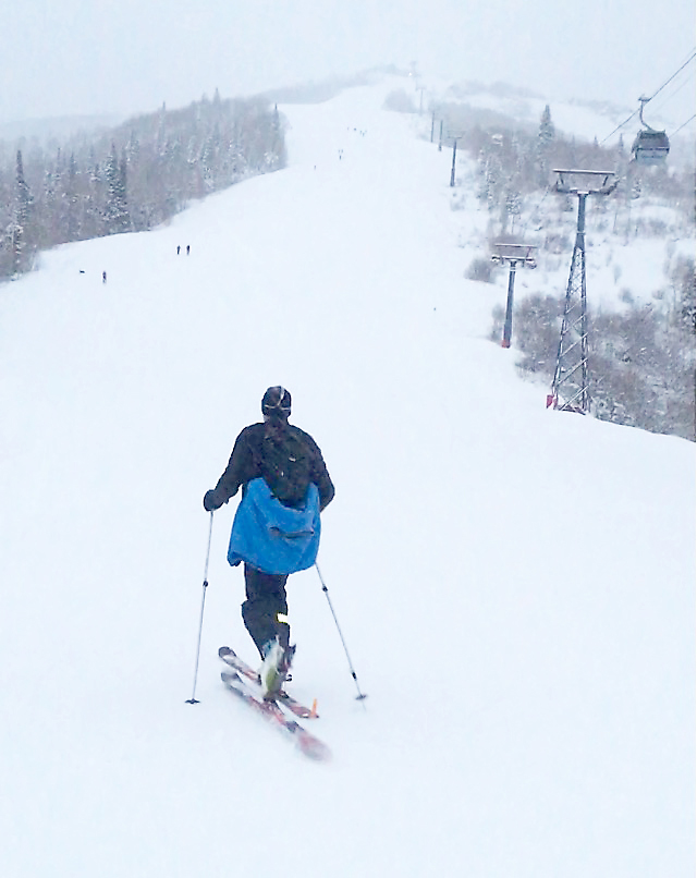 """Skiers headed from Christie Summit to Thunderhead soon became vanishing ants in a Dcc. 9 snowstorm. Uphill skiing is becoming increasingly popular for fitness fans who value the experience of """"earning their turns."""""""