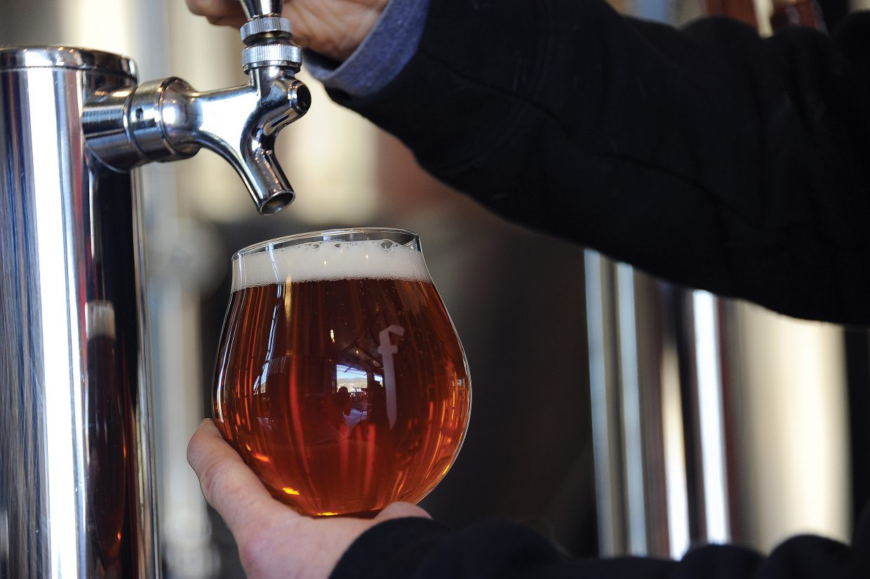 Butcherknife Brewing Co.'s Amputator IPA is poured at the brewery's tap room in Steamboat Springs.