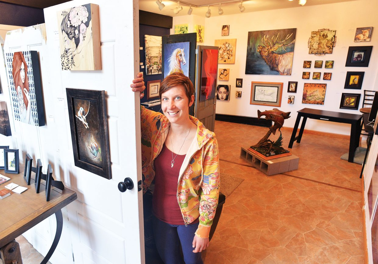 Johanna Hall, director of the Closer to the Sun, Gallery of Fine Art, stands inside the new business at 635 Lincoln Ave. The art gallery, which is owned by Jonathan Barrett, and the BARley will host a Steamboat Creatives happy hour Thursday evening.