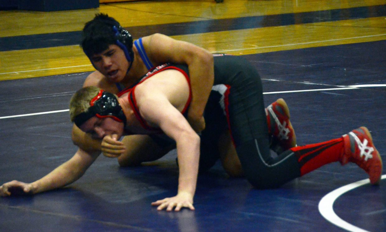 Moffat County High School's Hugo Hernandez works toward a win during the team's duals with Steamboat Springs on Wednesday night in Craig. MCHS won the overall event, 49-27.